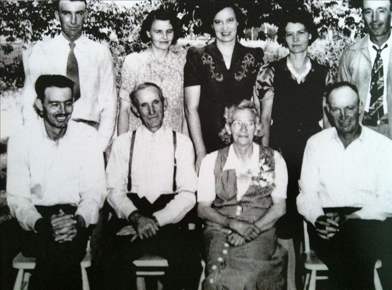 From left to right starting with the front row (all Woodbury): Glen, Angus Cannon (father), Diantha Rogers (mother), Leland, (back) LeGrande, Anna, Lucille, Aretta, and Raymond